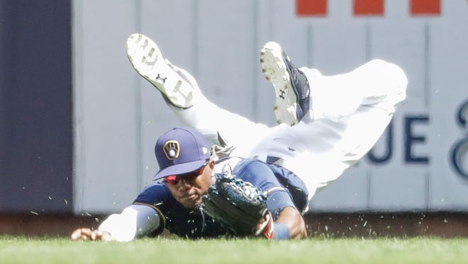 Lewis Brinson had three stints with the Brewers this season before injuring his hamstring.