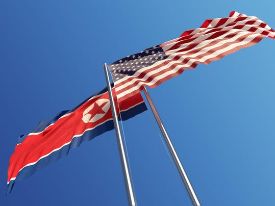 American and North Korean Flags Waving With Wind: Dispute Concept