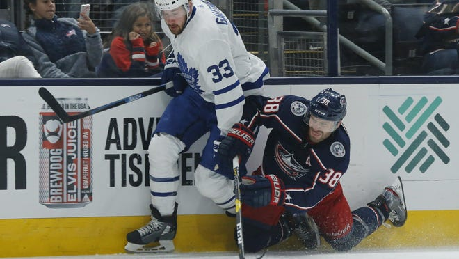 The Blue Jackets' Boone Jenner (38), colliding with Maple Leafs center Frederik Gauthier on Oct. 4, spent much of his career as a wing before shifting to center last season.