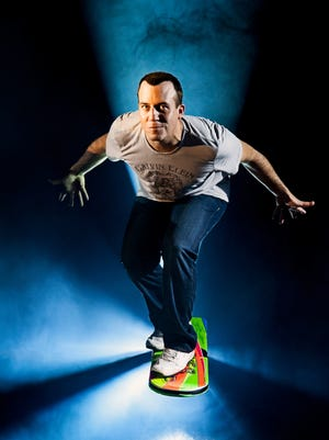 Magician and illusionist Bill Blagg rides a hoverboard.