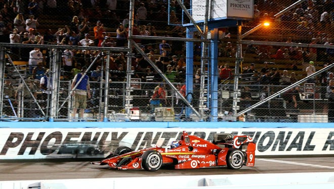 Verizon IndyCar Series driver Scott Dixon takes the checkered flag to win the Phoenix Grand Prix at Phoenix International Raceway.