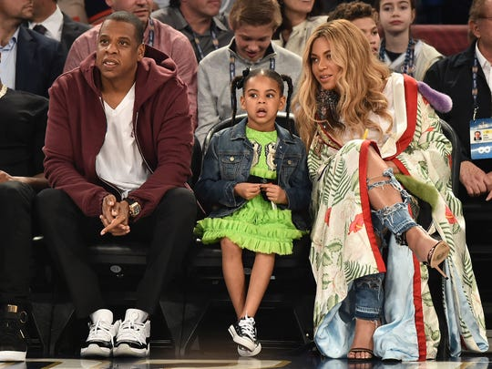 Jay Z, Blue Ivy Carter and Beyoncé Knowles took in