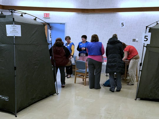Chemung County Health Department workers and volunteers take part in a vaccination drill Thursday.