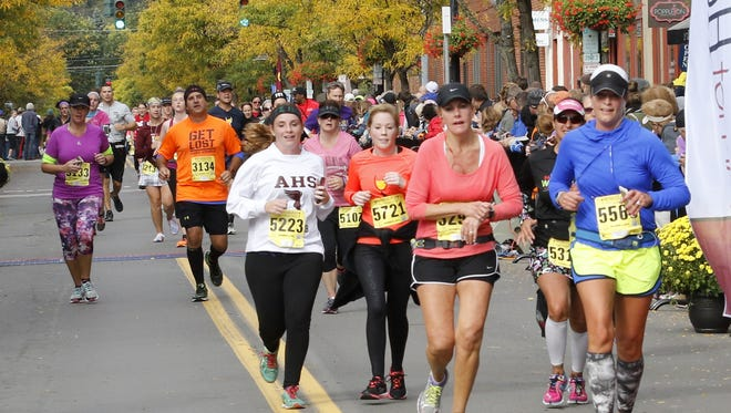 Runners compete in the Wineglass Marathon on Sunday in Corning.