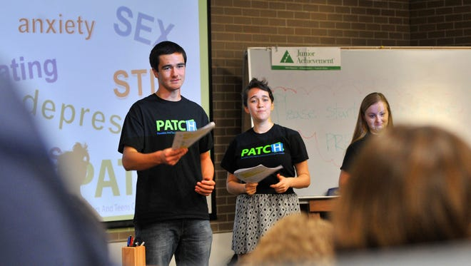 Teen educators Oliver Soler, left, his sister Eliette, and Gracie De Broux, answer students' questions during the PATCH program Wednesday afternoon at Wausau West High School. PATCH is a program to improve communication between teens and health care providers. The program is taught and facilitated by teen educations ages 15-17.
