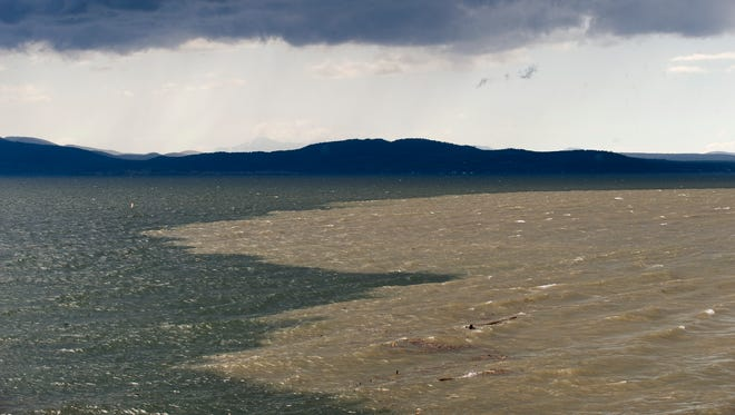 Silt, dirt and debris flow into Lake Champlain from the Winooski River in late April 2011.