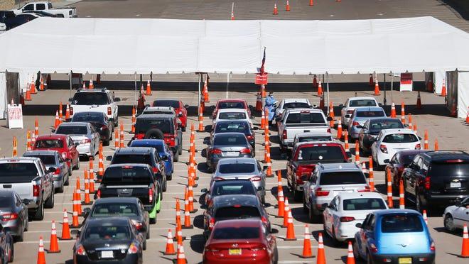 Cars line up at a drive-thru COVID-19 testing site Nov. 4 at the University of Texas at El Paso.