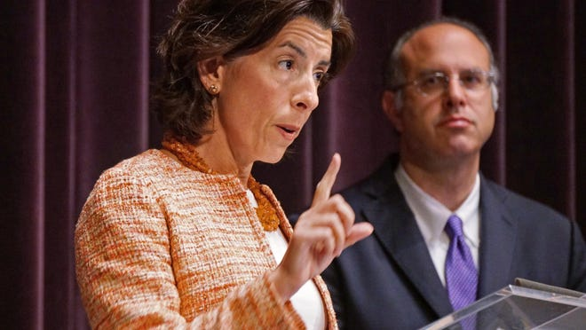 Gov. Gina Raimondo, accompanied by Commerce Secretary Stefan Pryor, holds Wednesday's coronavirus briefing.