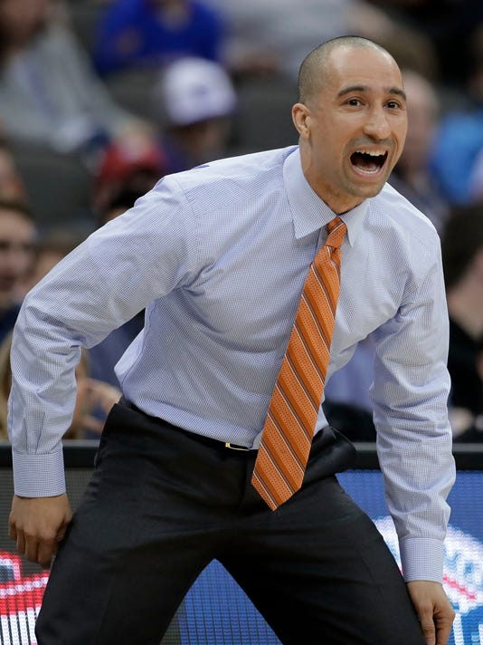 Texas coach Shaka Smart talks to his team during the first half of an NCAA college basketball game against Texas Tech in the Big 12 tournament Wednesday, March 8, 2017, in Kansas City, Mo. (AP Photo/Charlie Riedel)