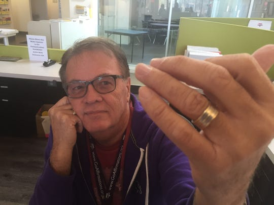 Jeff Lightfoot, 67, shows off the ring from his marriage to Ron Reick, 56. The Southfield couple married in Florida because they could not marry in Michigan.