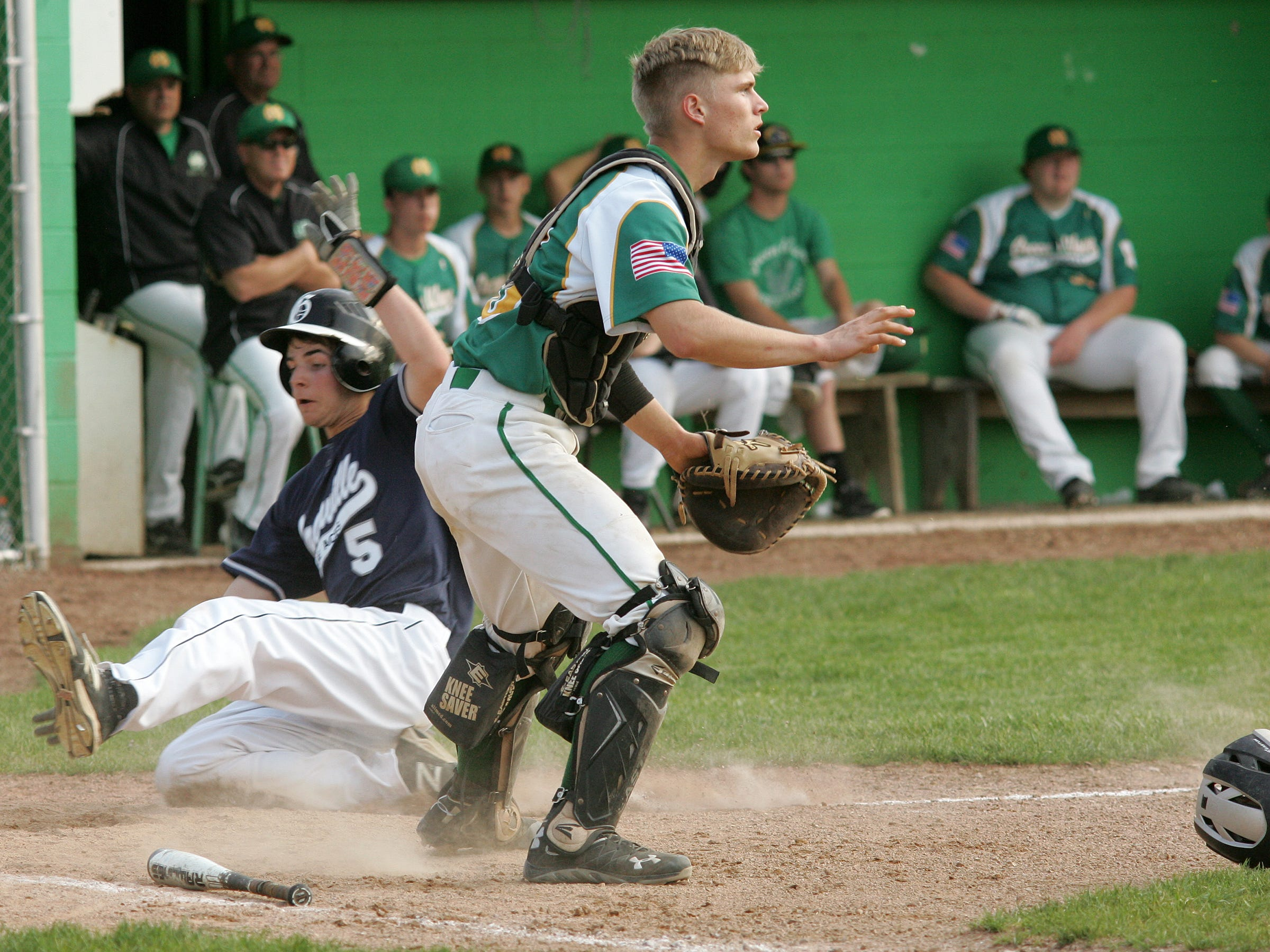 Granville's Zach Blumling slides in for the only run of the Blue Aces' 1-0 victory May 6 against Newark Catholic. The Blue Aces began play in the Division II tournament this week.