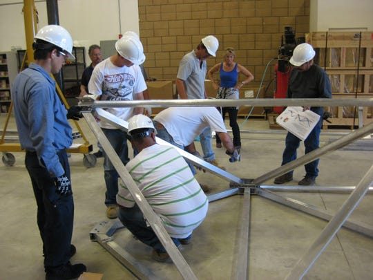 """Solar energy students work on a project. Renova Solar works """"hand-in-hand"""" with College of the Desert on a 60-hour training class that prepares solar trainees for their accreditation test."""