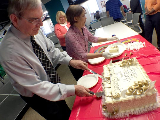 Free Press Publisher and Editor Paul Anger and his executive assistant, Jody Williams, cut birthday cake marking the news organization's 184th birthday on May 6. Anger retired Friday after 10 years at the Free Press.