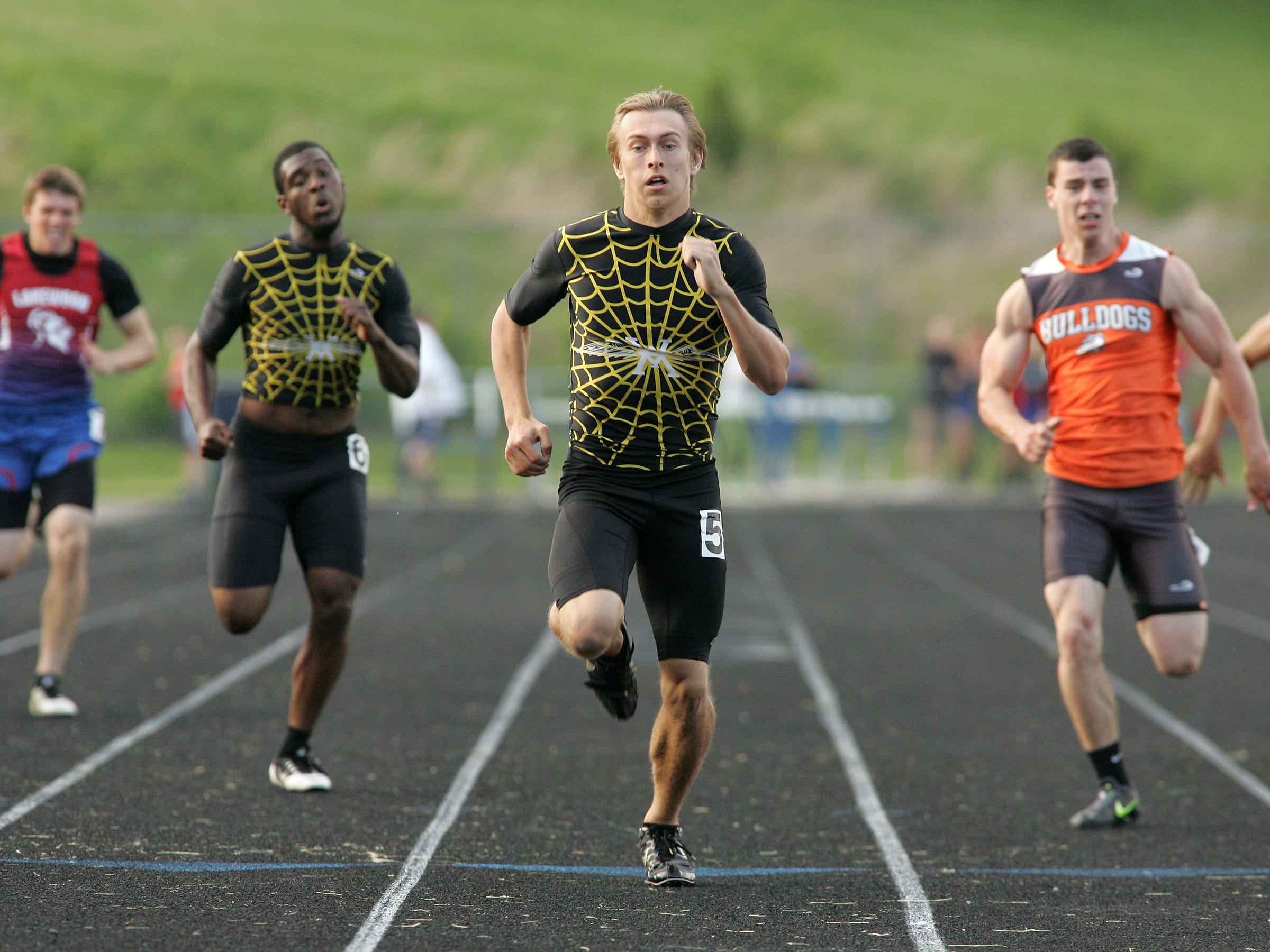 Watkins Memorial senior Evan Caniff, center, nears the finish line in the 200 this past Friday during the Licking County League meet. Caniff won the event, and teammate Solomon Broomfield, left, placed third.