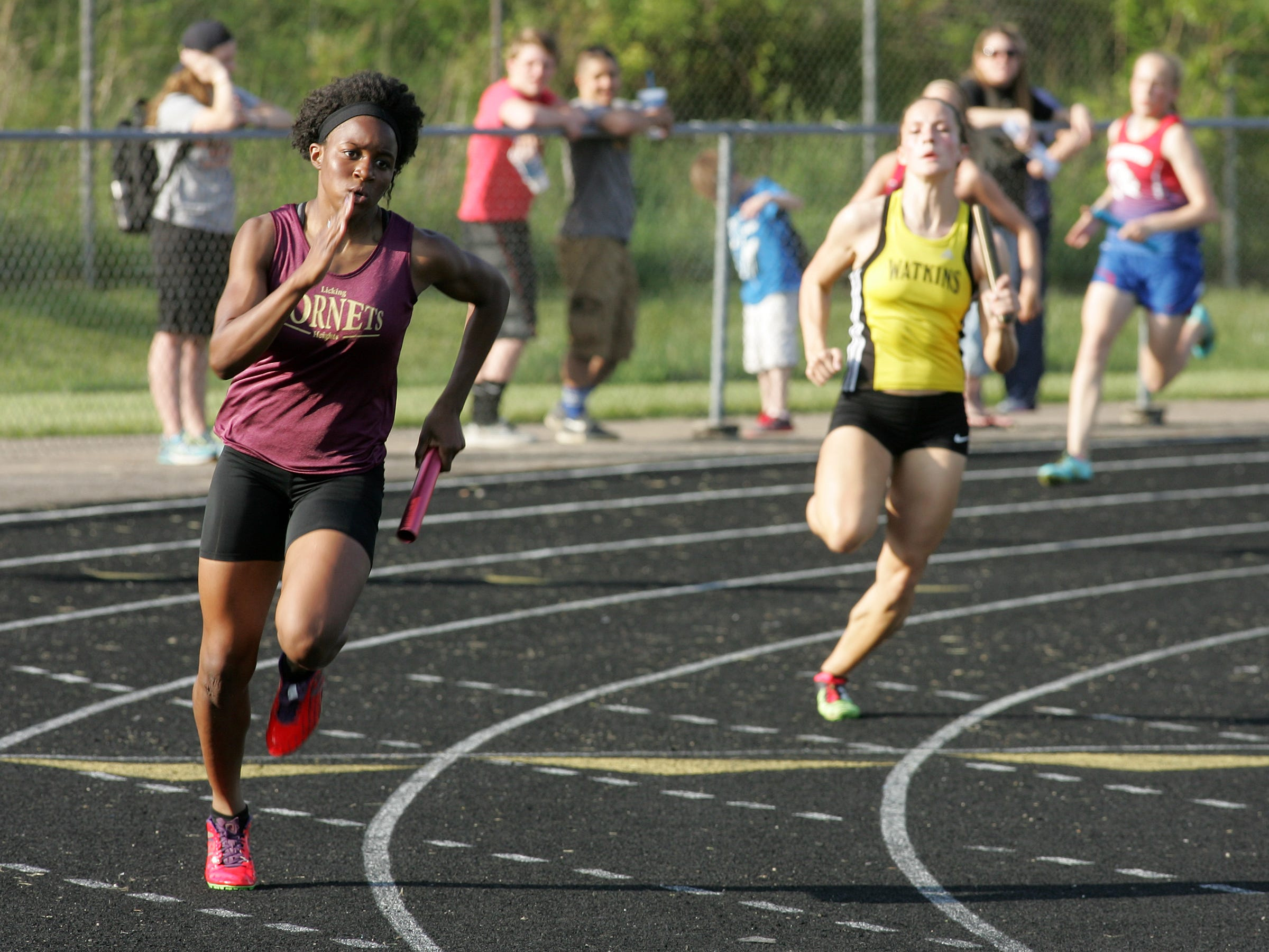 Licking Heights' Chanlier Myers, left, runs the second leg of the 4x200 relay this past Friday during the Licking County League meet at Granville. Myers later won the 200.