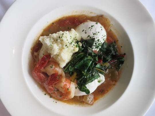 Shrimp and grits at Joe Muer Seafood's new Sunday brunch is served with poached eggs, Swiss chard and étouffée sauce.