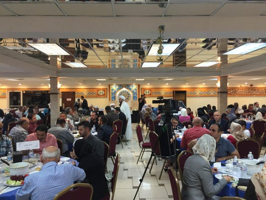 Imam Mohammad Ali Elahi, speaks to guests in the center of the Islamic House of Wisdom in Dearborn Heights during a Ramadan iftar dinner, July 1, 2015. Niraj Warikoo/Detroit Free Pres