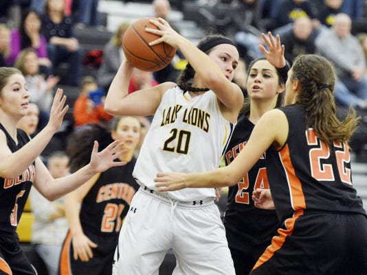 Red Lion's Amy Maciejewski (20) is swarmed by Central York defenders including Lydia Shellenberger (24) and Sarah Sepic (22) in the second half of a YAIAA girls basketball game on Friday, Jan. 16, 2015. The Lady Lions struggled on offense in 30-18 defeat to the Panthers. Jeff Lautenberger ? For GameTimePA.com