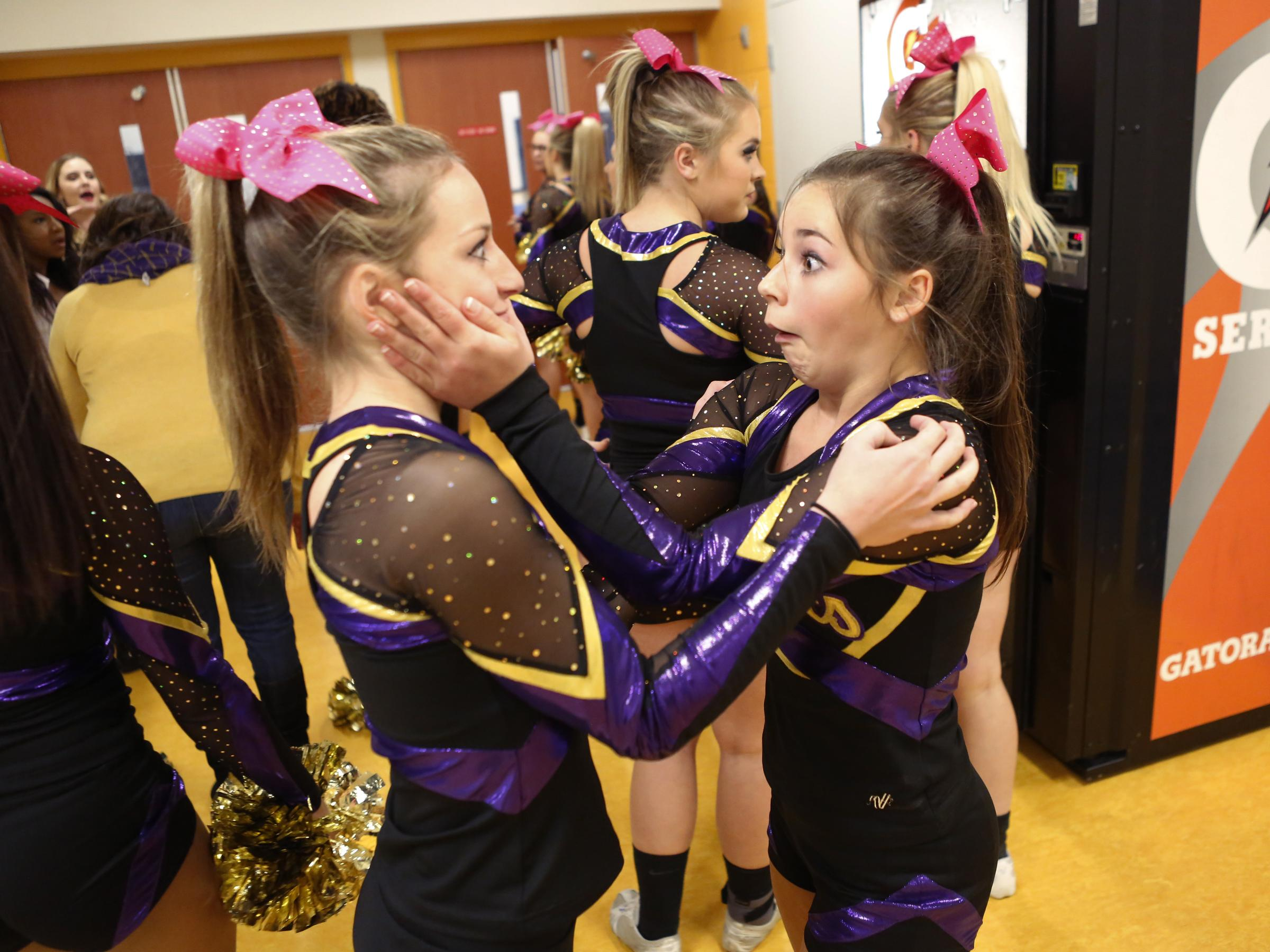 Nervous before the first round of their Conference 29 competition cheer championship, Brooklyn Sims, right, grabs onto her teammate and fellow Waynesboro classmate Sonny Carey at Fluvanna County High School on Saturday.
