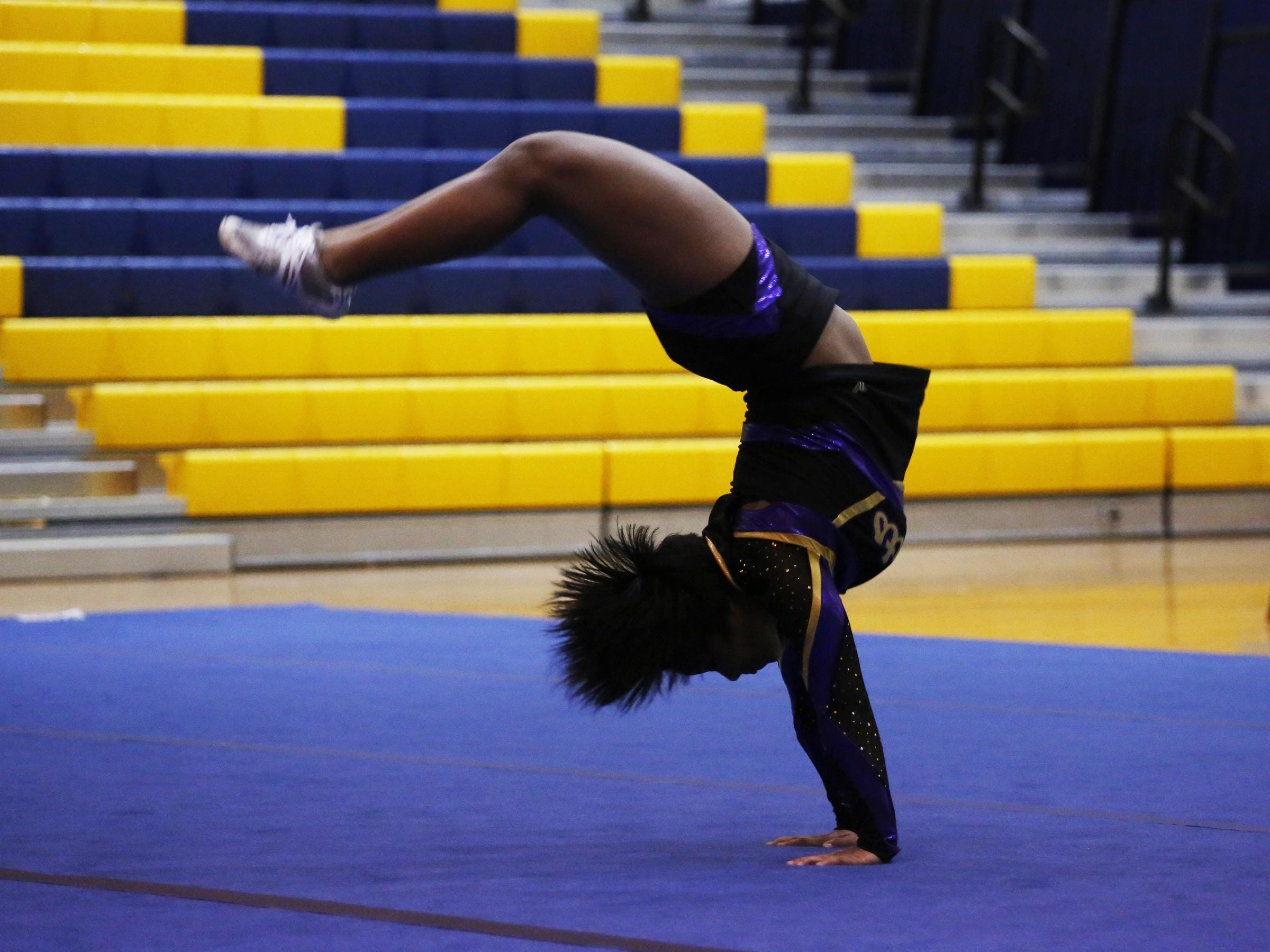 Waynesboro's Bryahnna Trice flips across the mat during the Conference 29 competition cheer championship at Fluvanna County High School on Saturday.