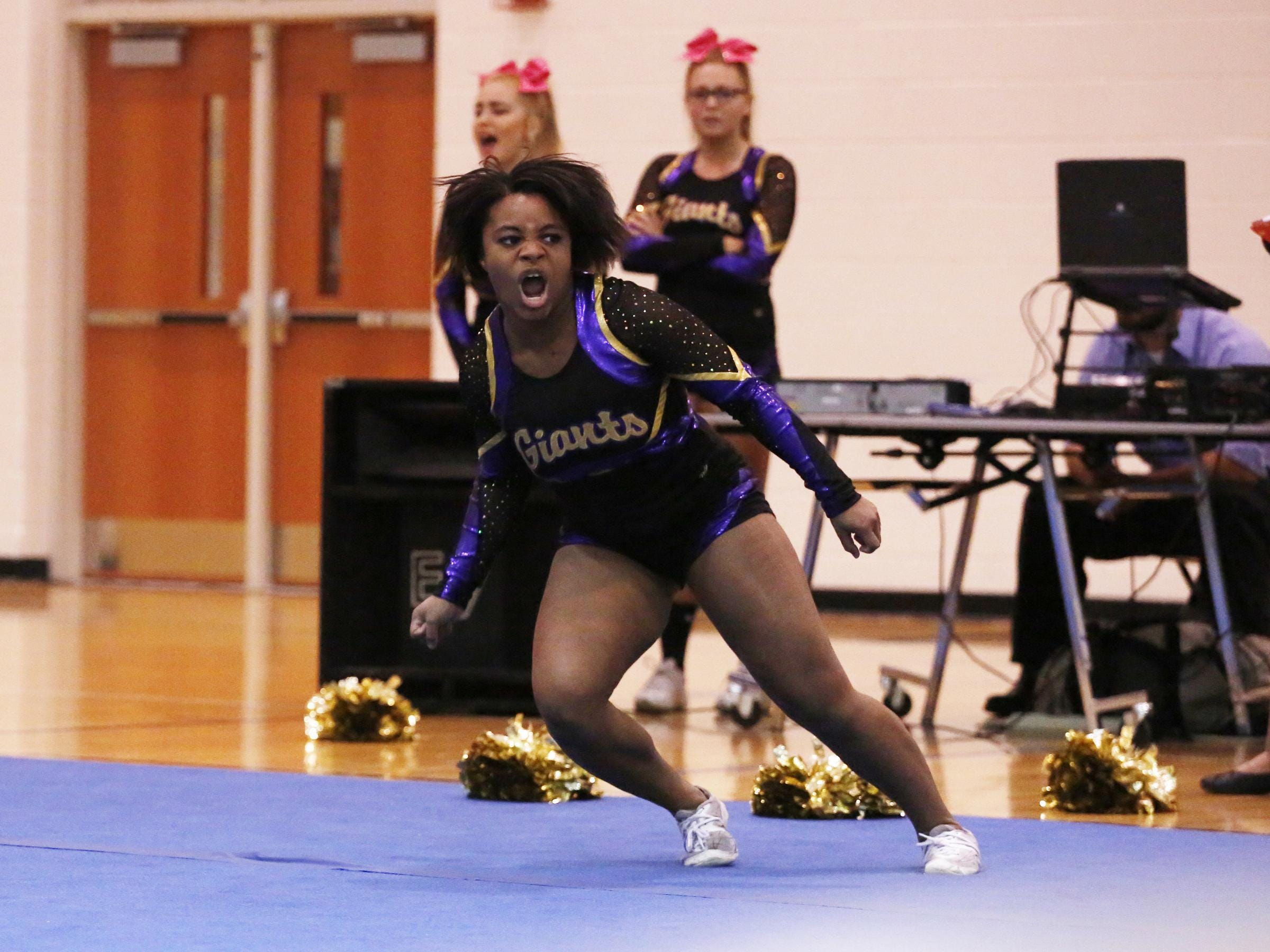 Waynesboro's Bryahnna Trice shouts after flipping across the mat during the Conference 29 competition cheer championship at Fluvanna County High School on Saturday.
