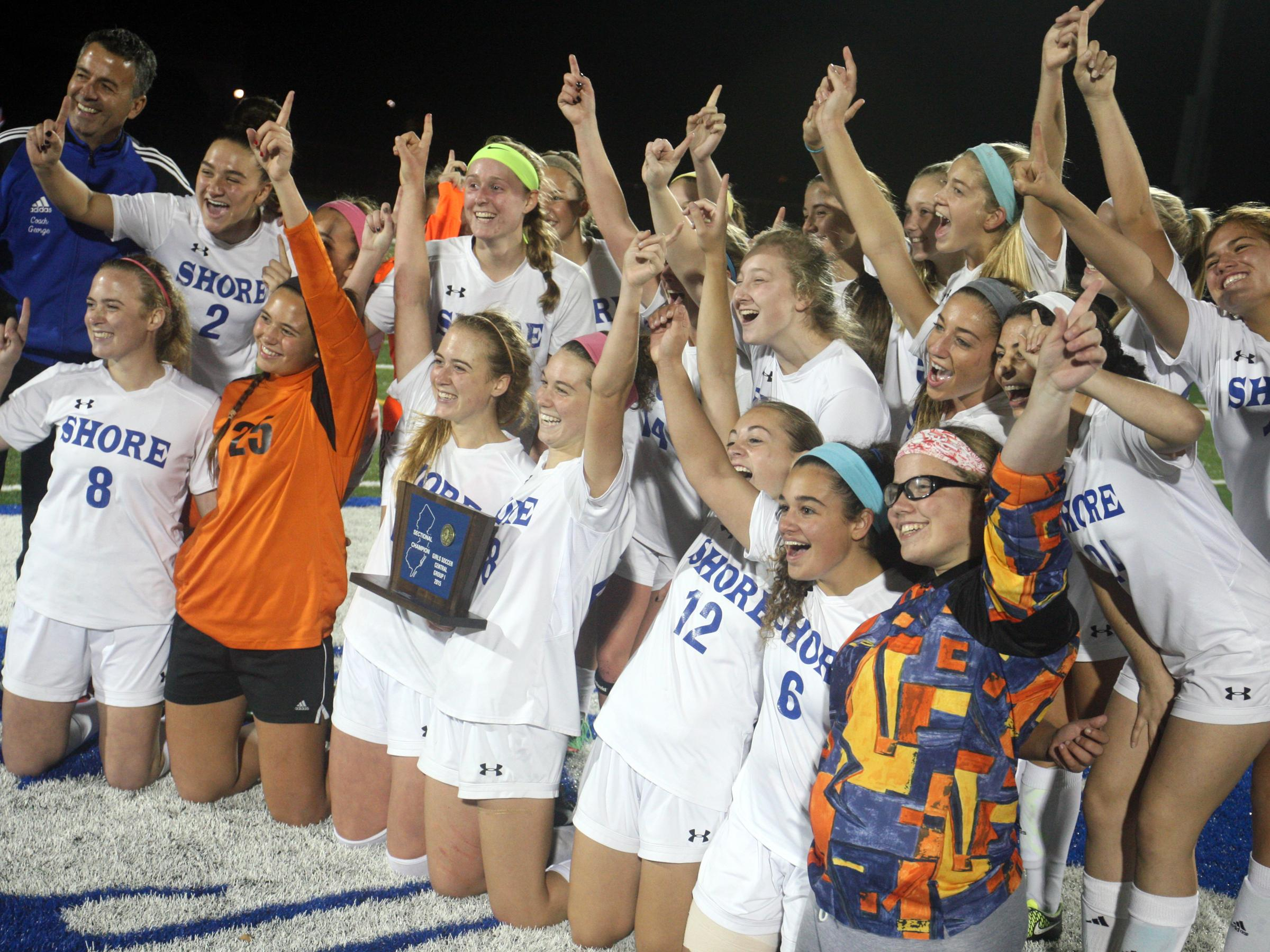 Shore Regional celebrates the 4-0 win over Metuchen in the Central Group I girls soccer sectional final, Thursday, November 12, 2015, in West Long Branch.