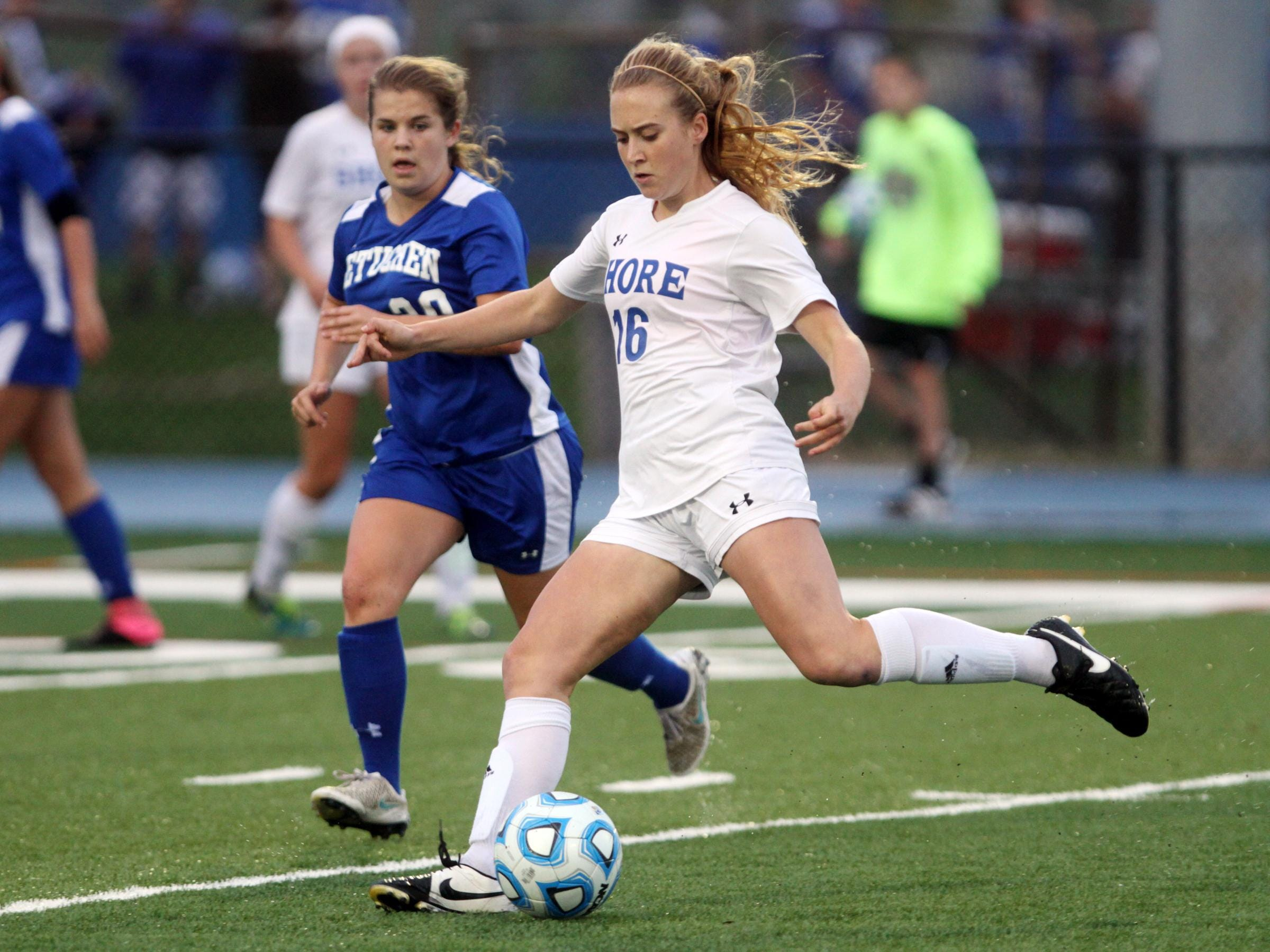 Shore Regional's Jessica Egan boots the ball in front of Metuchen's Katharine Chura during the Central Group I girls soccer sectional final, Thursday, November 12, 2015, in West Long Branch.