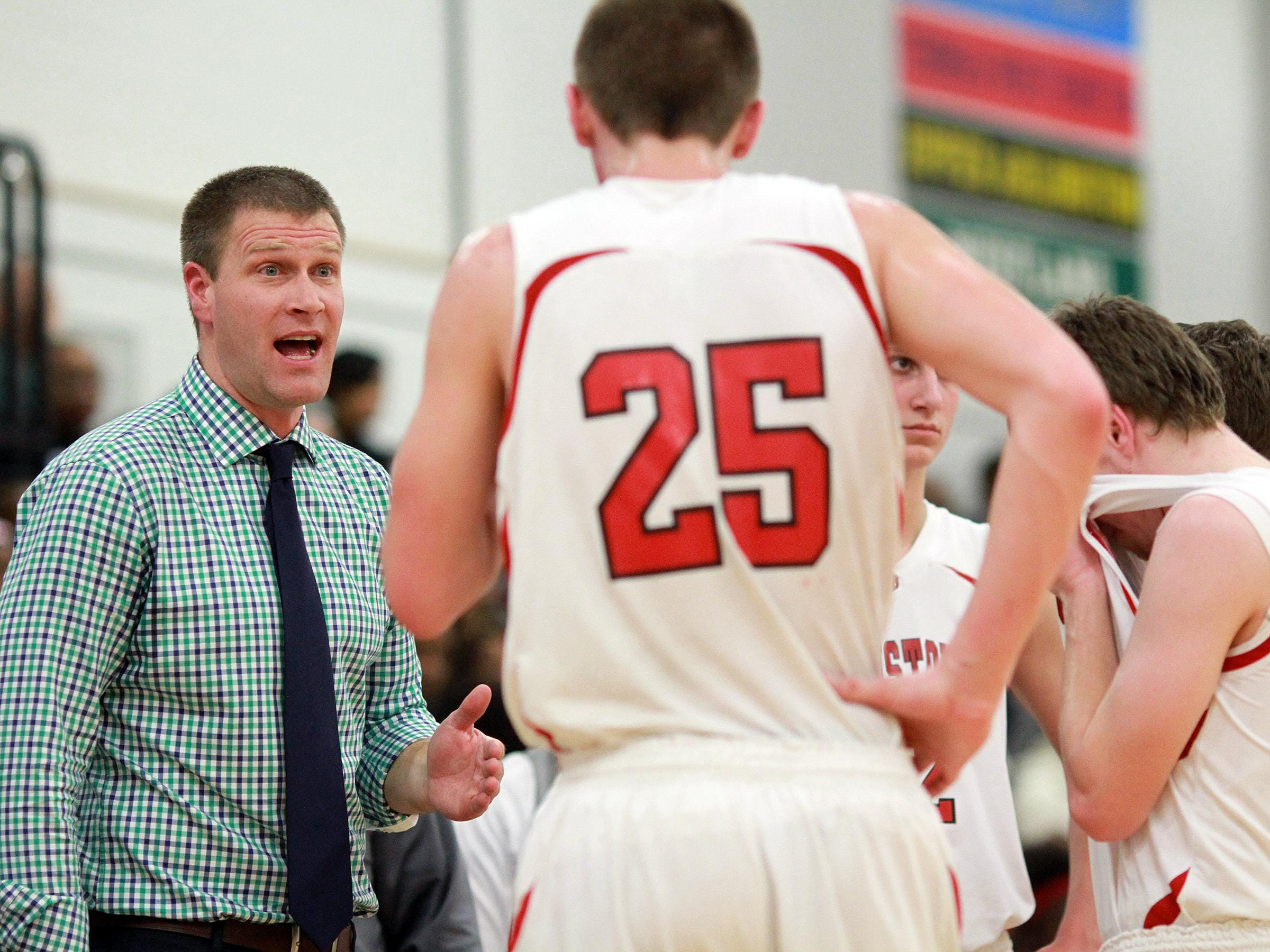Johnstown coach Kevin Martin talks to his team during a 2014-15 game.