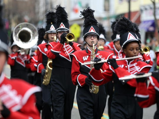 Members of the Woodbridge Barron's Marching Band perform during the St. Patricks Day parade, Sunday, March 13, 2016, in Woodbridge.
