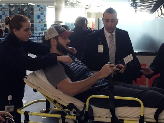 People carry William Jacob Raak, 35, a Delaware business owner originally from Chadds Ford, Pennsylvania, on a stretcher as he returns back home at Ataturk Airport, in Istanbul, Monday, Jan. 2, 2017. Raak had been shot in the leg. A manhunt is on in Turkey as authorities work to identify the assailant who killed dozens of people in a crowded Istanbul nightclub during New Year's celebrations Sunday. (Faik Kaptan/ DHA - Depo Photos via AP)