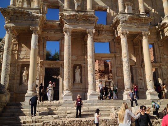 Tourists can't get enough pictures of themselves at the Celsus Library, the most famous structure at Ephesus, Turkey. Amid the crowd is reporter Ellen Creager (center).