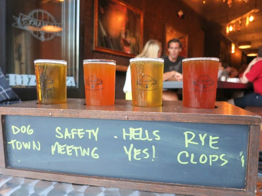 Beer samplers at Ale Mary's Beer Hall in Royal Oak are served in wooden holders with their names written on a chalkboard panel, so guests always know which brew is which.