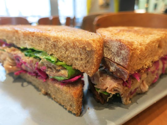 The Duck Reuben sandwich at Dime Store in downtown Detroit is made with rich, tender duck leg confit — made in-house by chef Josh Taylor — crisp-pickled red cabbage, Gruyere cheese and spicy whole-grain mustard on grilled rye bread.