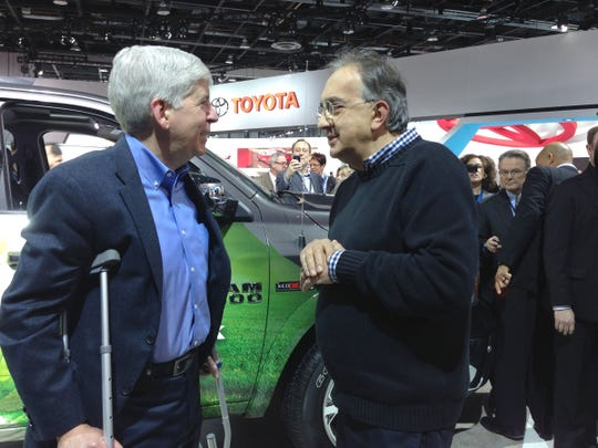 FCA CEO Sergio Marchionne speaks with Michigan Gov.