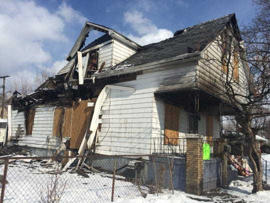 A two story house is 80% burned on Feb. 18, 2015.