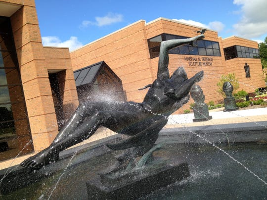 A sculpture and fountain in front of the Marshall Fredericks Sculpture Museum located on the campus of Saginaw Valley State University.