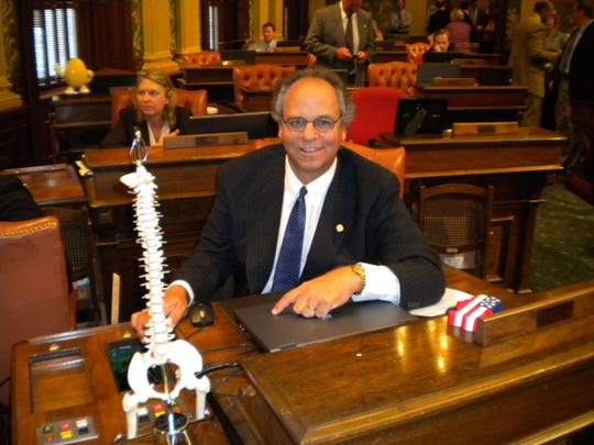 Former state Rep. Chuck Moss, R-Birmingham, kept a doctor's replica of a spine on his desk to remind him to have a backbone on tough issues.