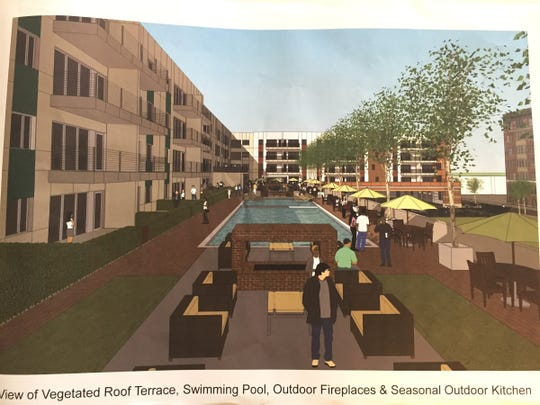 This rendering was submitted to Detroit City Council for a planned new mixed-use apartment complex in Midtown Detroit to be called the Scott @ Brush Park. The rendering shows the vegetated roof terrace, swimming pool, outdoor fireplaces and seasonal outdoor kitchen.