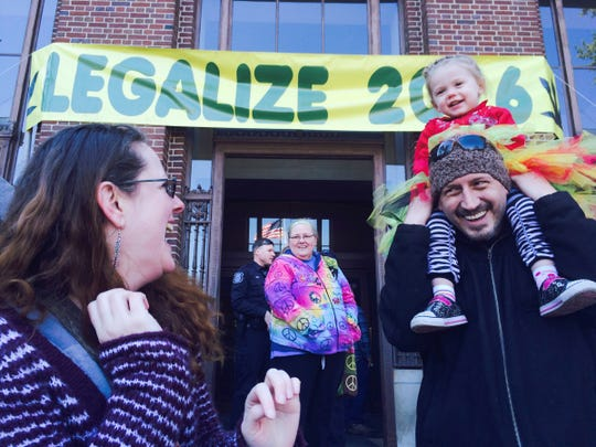 Steve Green, right, and his daughter, Bree, attend the 44th annual Hash Bash Saturday at the University of Michigan. Green won a legal battle to keep custody of his daughter while he uses medical marijuana.