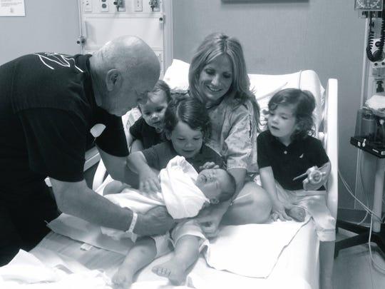 Peter Karmanos Jr., left, Spiros, Leonidas (holding baby Aristides Kyros), Danialle Karmanos and Socrates.