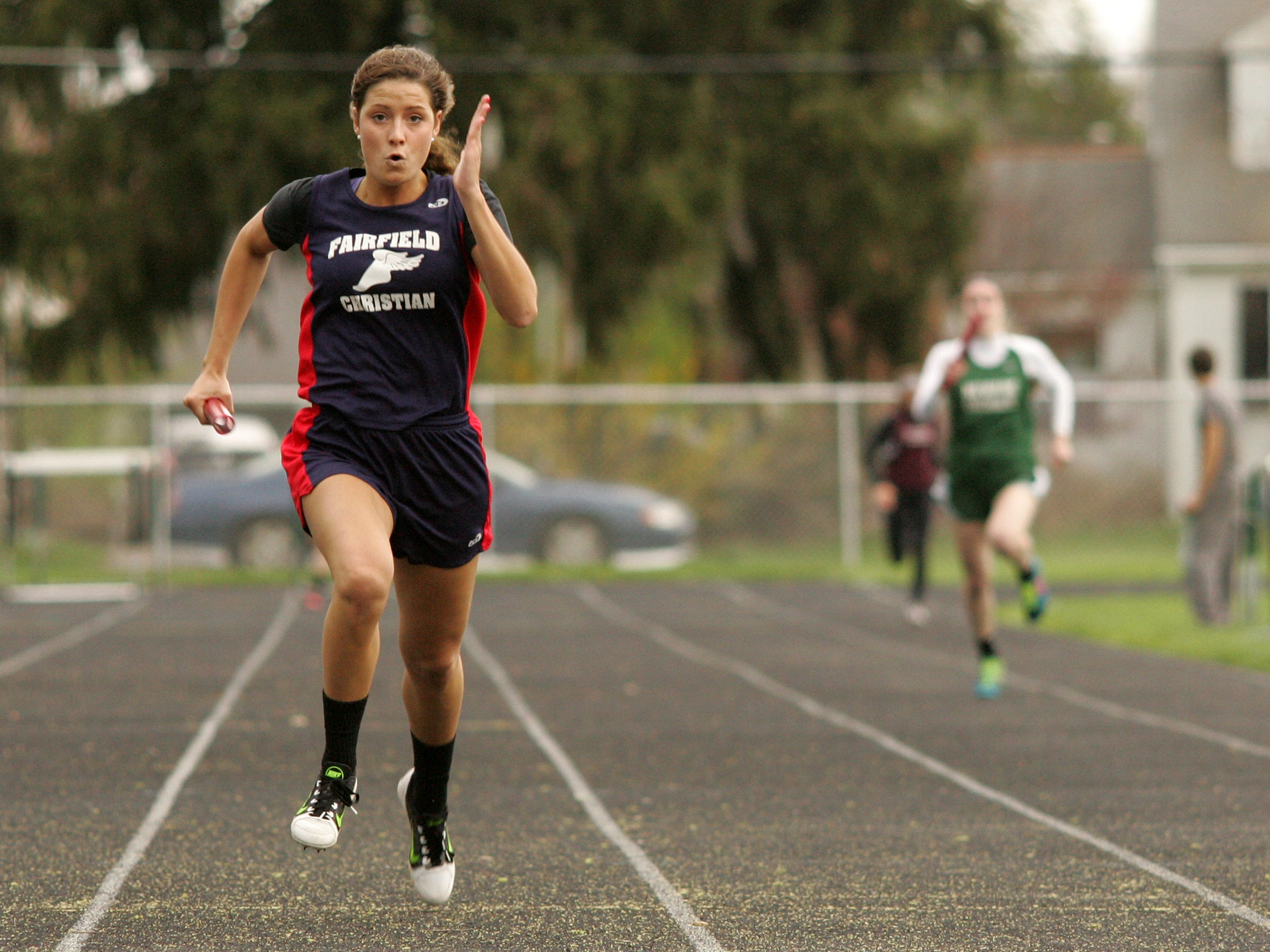 Fairfield Christian sophomore Ruthie Johnson anchors the 800 relay Monday during a meet at Newark Catholic. Johnson won the 100 and 400.