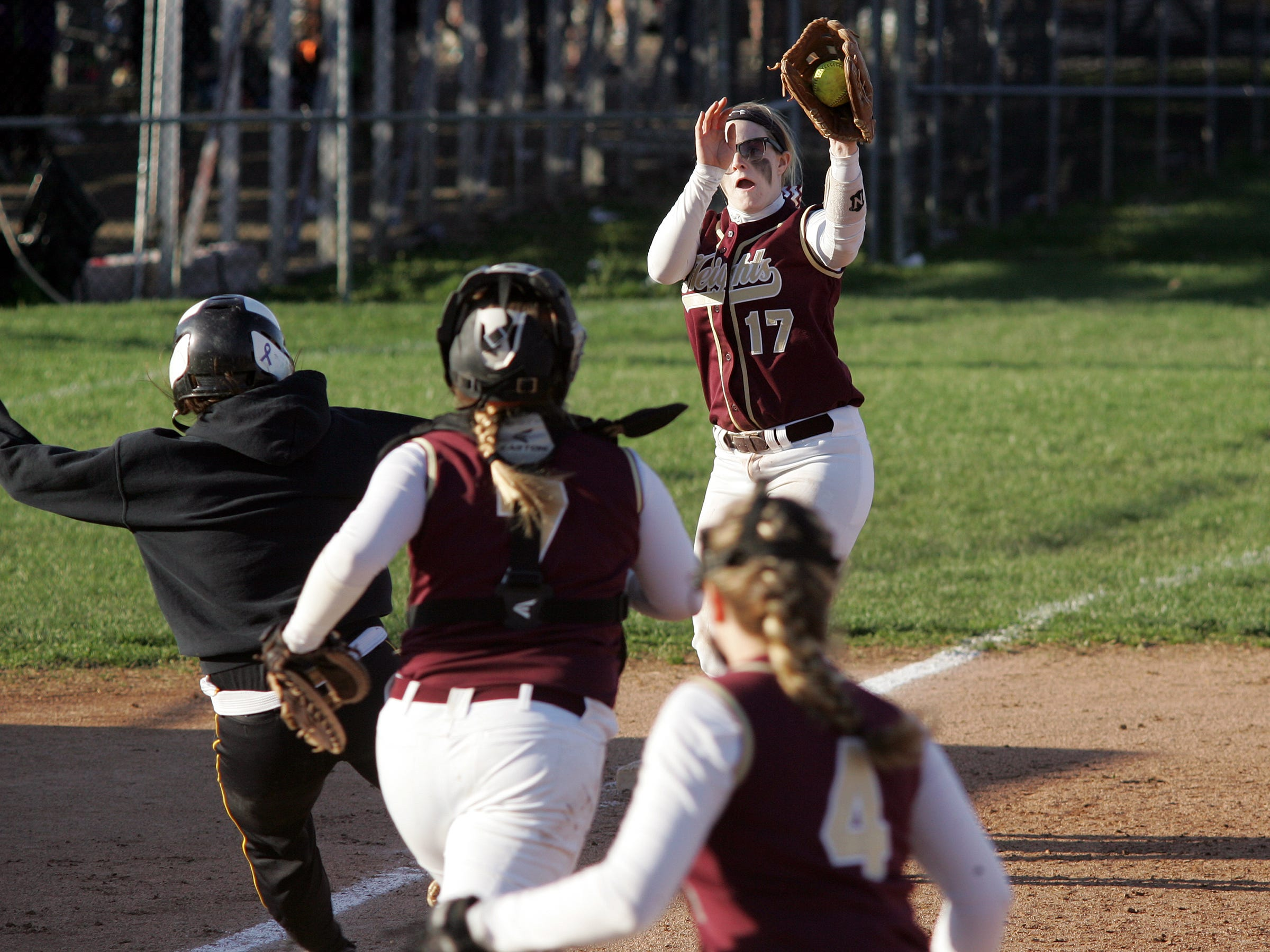 Licking Heights' Georganna Pendexter, top, chases down Watkins Memorial's Anna Shroyer in a rundown between third and home plate this past Friday during Watkins' 14-11 victory. The Hornets led 11-3 in the fifth inning before Watkins rallied.