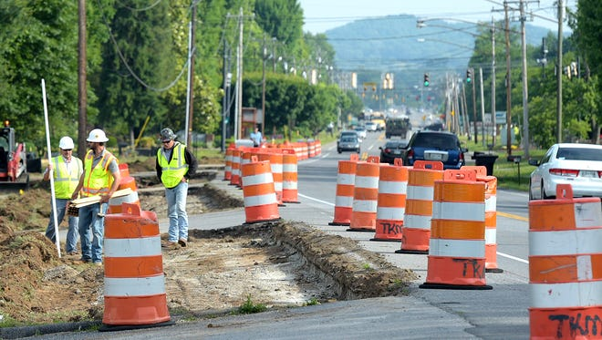 Construction crews widened Hillsboro Road, which included replacing sanitary sewer utility lines.