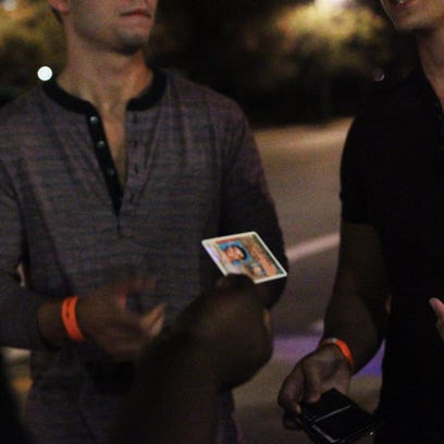 Two men fail to persuade security at a Gaines Street bar to admit one of them with an expired license.