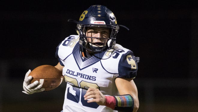 Tyler Dittmer (36) finds open field during the Gulf Breeze vs Pace high school football game at Pace High School on Friday, October 13, 2017.