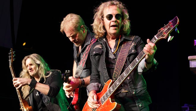 Joel Hoekstra, Brad Gillis and Jack Blades of the rock band Night Ranger perform in April 2014, in Columbia, Md.