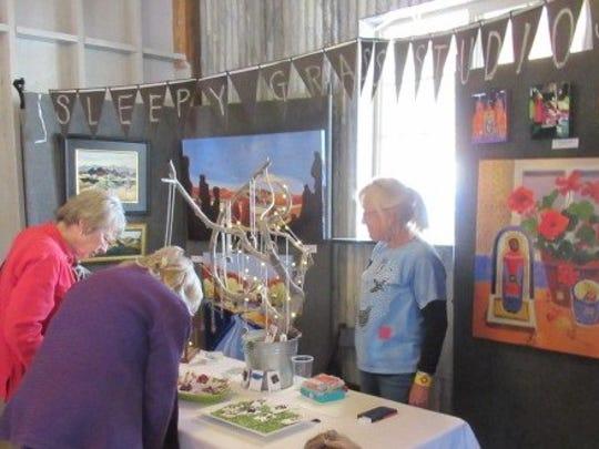 Visitors anticipate a purchase at one vendor's area.