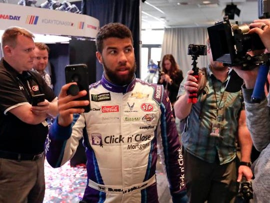 Darrell Wallace Jr. takes a selfie video as he walks
