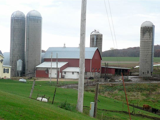 Red barn, tall silos, green grass and a dream come