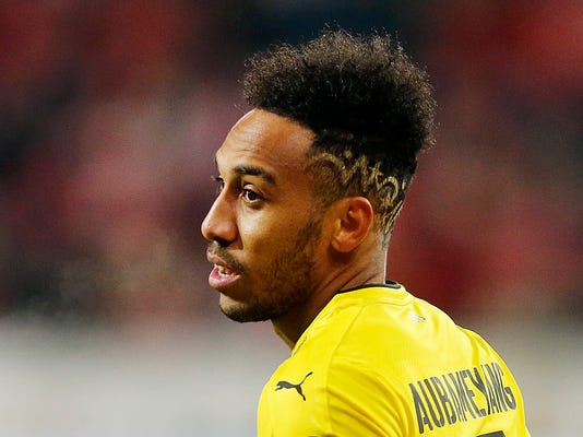FILE - In this Dec. 12, 2017 file photo Dortmund's Pierre-Emerick Aubameyang looks on during a German first division Bundesliga soccer match between FSV Mainz 05 and Borussia Dortmund in Mainz, Germany. (AP Photo/Michael Probst, file)